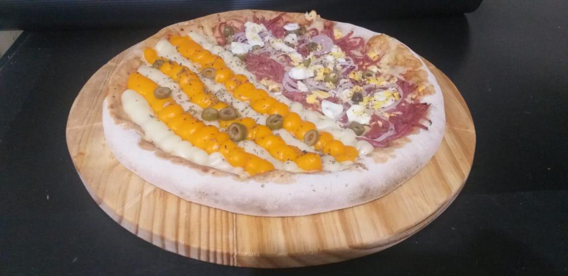 Pizza onde você estiver! Pizza Grande da linha Especial ou Tradicional por apenas R$19,90 no Hot's Pizzas